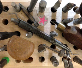 Close-up of Moore Wood Type's tools